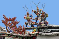 Warriors on a temple roof. Warriors on a roof of a Vietnamese palace stock images