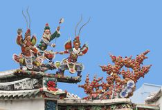 Warriors on a temple roof. Warriors on a roof of a Vietnamese palace royalty free stock image