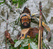 Warriors tribe Yaffi in war paint with bows and arrows in the cave. New Guinea Island Stock Images