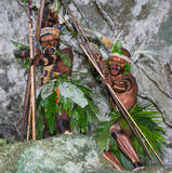 Warriors tribe Yaffi in war paint with bows and arrows in the cave. New Guinea Island Stock Photo
