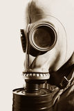 Wars Of Yesteryear. Close-up Portrait Of A Man Wearing A Historic German Gas Mask Royalty Free Stock Photos
