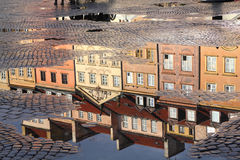 Warsaw. Poland. Old Town rain puddle reflection - tenements at the main square. UNESCO World Heritage Site Royalty Free Stock Photos