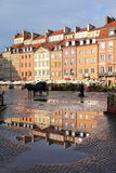 Warsaw. Poland. Old Town rain puddle reflection - tenements at the main square. UNESCO World Heritage Site Royalty Free Stock Photography
