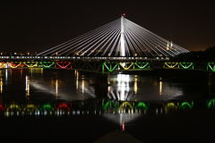 Warsaw bridges at night. Night view of illuminated bridges over Vistula River in Warsaw, Poland royalty free stock photos