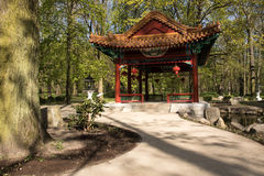 Warsaw.Chinese Garden in Lazienki Royal (Bath) Park. Poland.Warsaw.Horizontal view of the Chinese Pavilion in Chinese garden in Lazienki (Bath) Royal park.Photo Stock Images