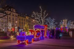 Warsaw Christmas lights. One of the streets of the Polish capital decorated with lights and other Christmas decorations - Warsaw, Poland stock photo