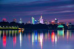 Warsaw city center at night. View from the Vistula River to the center of Warsaw at night stock images