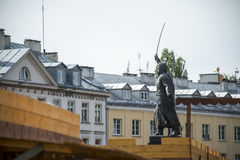 Warsaw city in poland house background Statue in front that pays tribute to Jan Kilinski Royalty Free Stock Image