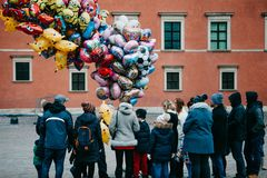 People are waiting in line to buy balloons for fun. Warsaw, December 25, 2017: People in the main city square are waiting in line to buy balloons for fun royalty free stock photo