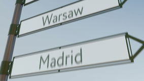 Warsaw direction sign on road signpost with European cities captions. 4K conceptual clip. Warsaw direction sign on road signpost with European cities captions stock video footage