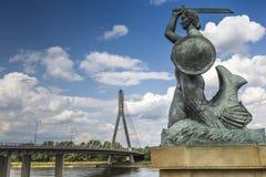The Warsaw Mermaid called Syrenka on the Vistula River bank in W Royalty Free Stock Photo