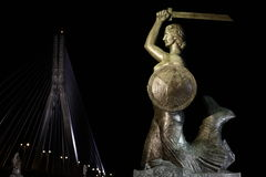 Warsaw Mermaid at night. The monument of famous Syrenka & x28;Mermaid& x29; with a shield and a sword - symbol of Warsaw & x28;Poland& x29; and Swietokrzyski royalty free stock image