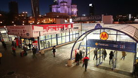Warsaw Metro Station Centrum by Night. WARSAW, POLAND - CIRCA DECEMBER 2014: People at main metro station Centrum of Line 1 at night and shopping arcade, Warsaw stock footage