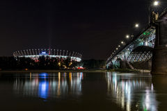 Warsaw National Stadium and bridge during the night. Stock Photography