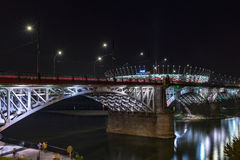 Warsaw National Stadium and bridge during the night. Stock Photos