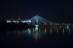 Warsaw by night bridge Swietokrzyski National Stadium and the Vistula river Stock Photography