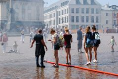 Warsaw Old Town. People playing in the water on a hot summer`s day in Warsaw, Poland royalty free stock image