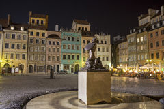 Warsaw - Old town square. The beautiful old town square of Warsaw by night - Mermaid monument royalty free stock photos