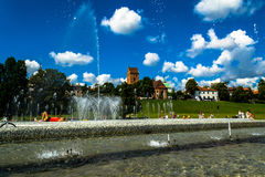 Warsaw, Poland – July 16, 2017: Fountains near the royal castle in Warsaw. Fountains multimedia park in Warsaw. Stock Photos