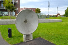 WARSAW, POLAND. An acoustic plate in the park of Openers. Center of science of Copernicus stock photography