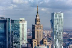 Warsaw / Poland - 03.16.2017: Aerial view at the old architecture building  and modern skyscrapers. Contrast view at the old architecture building  Palace of Royalty Free Stock Photo