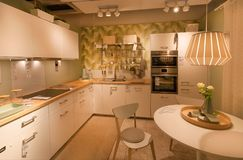 Modern kitchen with oven and fridge in IKEA store with furniture, decor and many products for home Royalty Free Stock Image