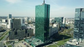 WARSAW, POLAND - APRIL, 1, 2017. Aerial shot of modern office building with INTRACO caption reflecting cityscape on a stock video footage
