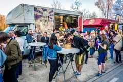 Food truck festival. Warsaw, Poland - April 1, 2017: People in front of food truck with Asian dumplings during food festival in Warsaw Royalty Free Stock Photography