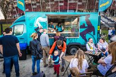 Food truck festival. Warsaw, Poland - April 1, 2017: People in front of food truck during food festival in Warsaw Stock Image