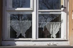 Tulle curtains in the old window in Warsaw Stock Photos