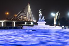 The mermaid statue in warsaw. Warsaw, Poland. April 6, 2019.  A view of  the mermaid statue in warsaw in the lights of the night royalty free stock images