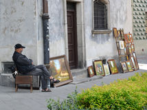 WARSAW, POLAND. The artist sells the works on the street of the Old city Royalty Free Stock Photography