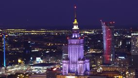 WARSAW, POLAND - AUGUST 26, 2017. Aerial shot of downtown high-rise buildings illuminated at night. WARSAW, POLAND - AUGUST 26, 2017. Aerial shot of downtown Stock Photography