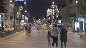 WARSAW, POLAND - AUGUST 4, 2018. Crowded pedestrian street in city centre in the evening Royalty Free Stock Photography