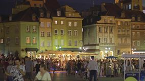 WARSAW, POLAND - AUGUST 4, 2018. Crowded square in old town in the evening