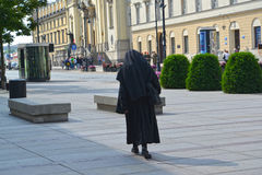 WARSAW, POLAND. The Catholic nun goes to a church of the Sacred Cross Royalty Free Stock Photos