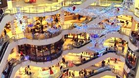 WARSAW, POLAND - DECEMBER, 18, 2016. 4K tilt video of Christmas sale at typical modern shopping center. WARSAW, POLAND - DECEMBER, 18, 2016. 4K tilt shot of stock video footage