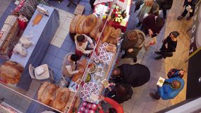 WARSAW, POLAND - DECEMBER, 18, 2016. 4K view from above video of Christmas bazar booth with traditional bread and. WARSAW, POLAND - DECEMBER, 18, 2016. 4K view stock footage