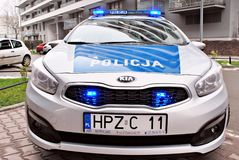 Kia Seed polish police car at the city street. Warsaw,Poland. 1 December 2017.  Kia Seed polish police car at the city street Royalty Free Stock Photography