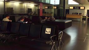 WARSAW, POLAND - DECEMBER, 24 Passengers at international airport terminal departure lounge. Reserved seats for pregnant Royalty Free Stock Image