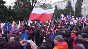 WARSAW, POLAND - DECEMBER, 17, 2016. Protesters with Polish and EU flags call for press freedom Royalty Free Stock Image