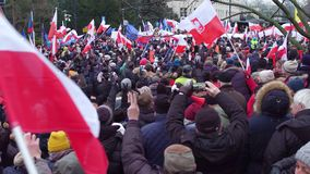 WARSAW, POLAND - DECEMBER, 17, 2016. Protesters with Polish and EU flags Stock Photo