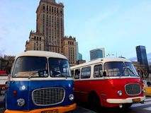 Retro buses and the Palace of Culture and Science. Warsaw, Poland - December 15, 2017: Retro buses and the Palace of Culture and Science, a notable high-rise Royalty Free Stock Photo