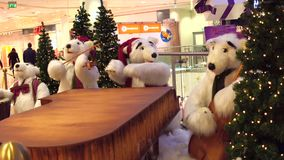WARSAW, POLAND - DECEMBER, 18, 2016. Toy polar bears Christmas band as a decoration in modern shopping mall Stock Photo