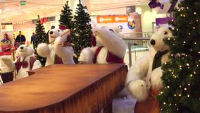 WARSAW, POLAND - DECEMBER, 18, 2016. Toy polar bears Christmas band as a decoration in modern shopping mall stock footage