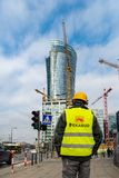 Warsaw Poland. February 18, 2019. The builder goes to construction along the road. Builder near the traffic light. The stock image