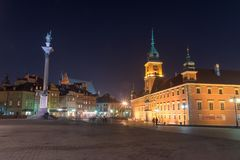 Royal Castle and Sigismund`s Column in Old Town of Warsaw at night royalty free stock images