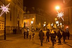 WARSAW, POLAND - JANUARY 02, 2016: Night view of Freta street in Christmas decoration. Near the Church of the Holy Spirit in the historic part of Warsaw Royalty Free Stock Photography