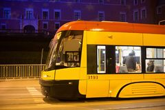 WARSAW, POLAND - JANUARY 01, 2016: Tram Pesa 120Na Swing in the Warsaw at night. royalty free stock photography