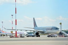 A7-AEC Qatar Airways Airbus A330-302 . The plane at the airport on loading at the airport in Chopin airport. Warsaw, Poland. 6 July 2018. A7-AEC Qatar Airways royalty free stock images